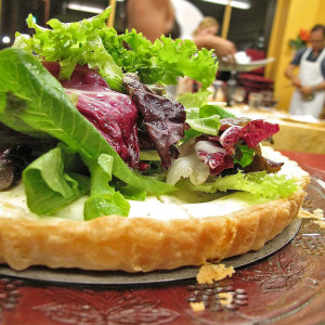 Thyme_and_Goat_Cheese_Tart_With_Mixed_Tender_Greens_in_Champagne_Vinaigrette